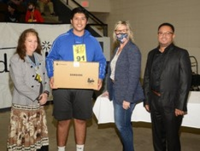Pictured from left to right- Susan Hoog (Spelling Bee Director), Braxton Santoyo, Tammy Toobes (OG&E Community Representative), and Marlon Coleman (Mayor of Muskogee).