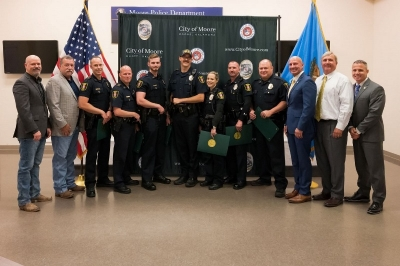 From left to Right: State Reps. Kevin West and Mark McBride, Moore Police Sgt. Eric Thomas, Staff Sgt. Gary Wallace, Officer Jeremy Darwent, Sgt. Jeffrey Shahan, Officer Sara Gurchinoff, Lt. Kevin Brown, Capt. David Seay, State Sen. Darrell Weaver, Moore City Manager Brooks Mitchell and Moore Chief of Police Todd Gibson.