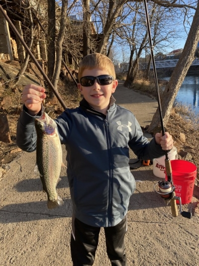 Fischer Perry with a trout he caught at the Medicine Creek trout area.