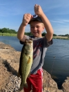 Marshall Fagg, 4 years old, caught this big bass all by himself at a private lake in Ponca City