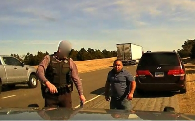 OBN Agent escorting Luy Fedy Ruby to K9 vehicle for questioning