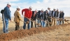 Supporters turn dirt during a groundbreaking ceremony for the Oklahoma Panhandle State University shooting sports complex