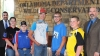 Oklahoma Archery in the Schools students who placed among the top five in NASP national shoots stand with OKNASP coordinator Jay Rouk, left, and Wildlife Department Director J.D. Strong, right. The archers are, from left, Madison Spoonemore, Locust Grove; Cayden Eyestone, Chandler; Jarod Aycox, Zaneis; Karson Warrington, Healdton; and Reece Marble, Salina. (Don P. Brown/ODWC)