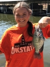 """Erin Thomas of Ponca City shows off a nice Kaw Lake crappie. Erin says """"Go Fishing"""" the spawn is on! She caught it using a jig and bobber set about a foot apart."""