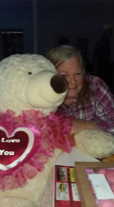 Bonnie Walton with the Teddy Bear (donated by Jessica Watts) that she won at the Valentines Day Dinner sponsored by the Talihina Chamber of Commerce and Visitors Center at Pistols and Pearls.