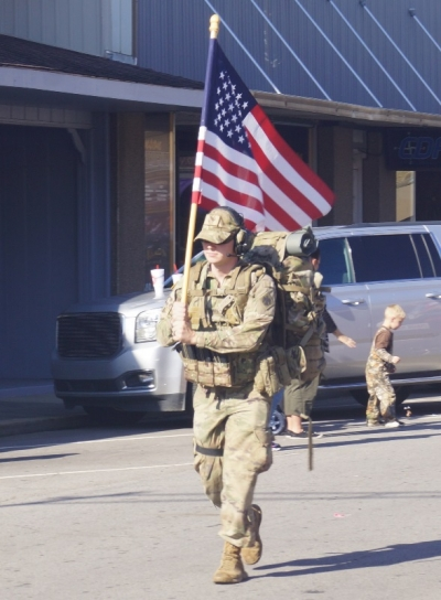 This soldier came all the way from Tulsa to carry the flag.