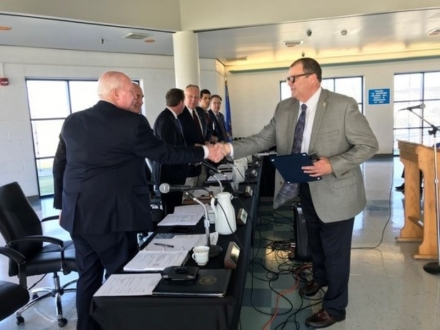 Oklahoma State Penitentiary's new Warden, Mike Carpenter, shakes hands with Board of Corrections members after his appointment approval on Thursday during the agency's monthly board meeting at Mack Alford Correctional Center in Stringtown. Carpenter has more than 30 years of experience at the Oklahoma Department of Corrections, and takes over the state's oldest prison after serving as its interim Warden since July.
