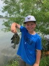 Rylan, age 11, with a nice bluegill he caught in a neighborhood pond. Share your catch with us on Facebook, Twitter and Instagram. Photo by Kurt Kuklinski.