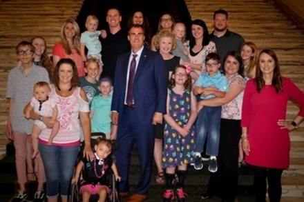 Governor Kevin Stitt is pictured with OSDH staff and families with children diagnosed with CMV.