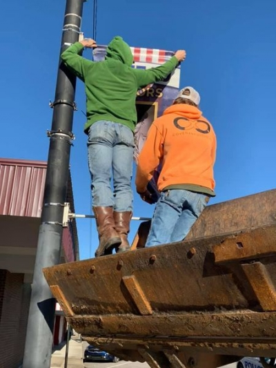 Poteau Chamber Beautification Committee And the City of Poteau Install Banners for Veterans Day